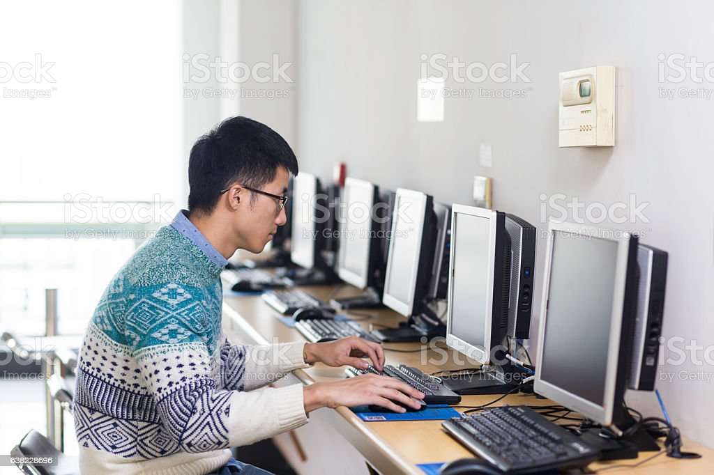 young asian man with pc stock photo