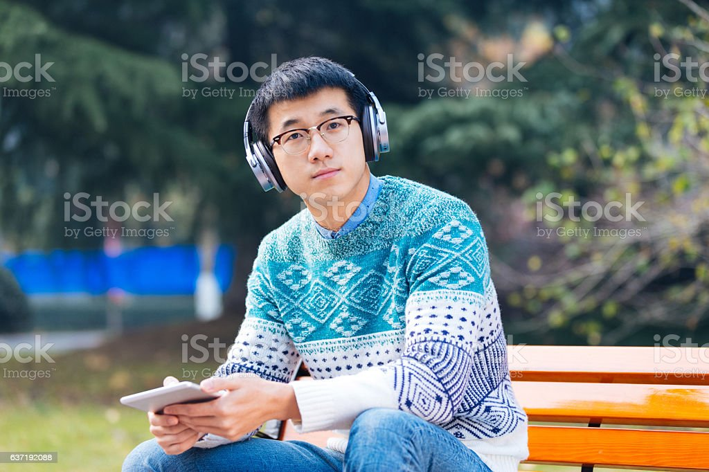 young asian man with tablet stock photo