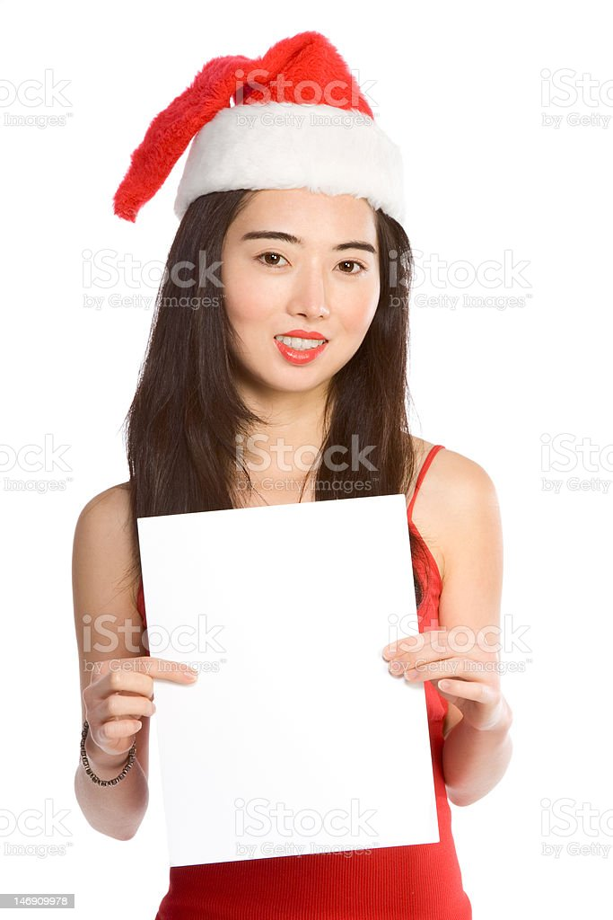 Young Asian Mrs. Santa with blank paper template royalty-free stock photo