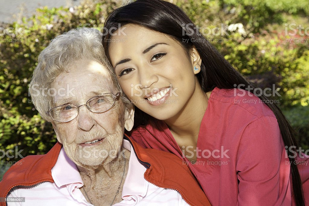 Young Asian Nurse With Happy Senior Adult Woman royalty-free stock photo