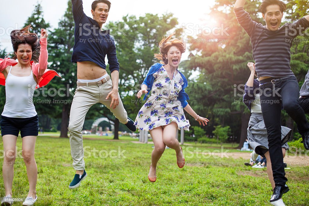 Young asian people having fun in the park, Tokyo. stock photo