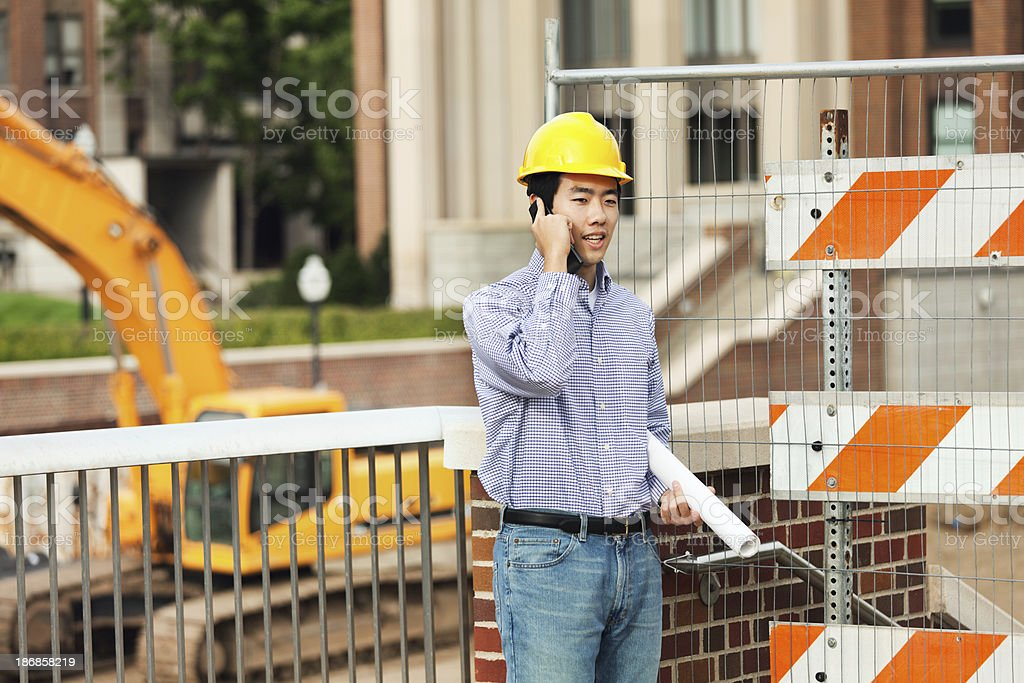 Young Asian Professional Engineer and Architect in Construction Site royalty-free stock photo