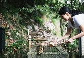 Young Asian Reaching for Water