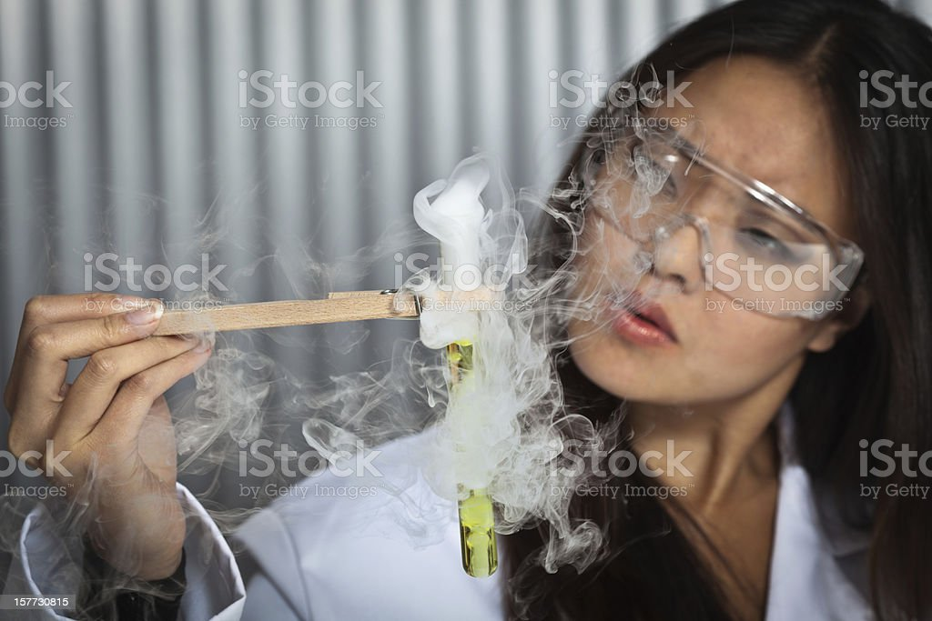 Young asian student smelling stock photo