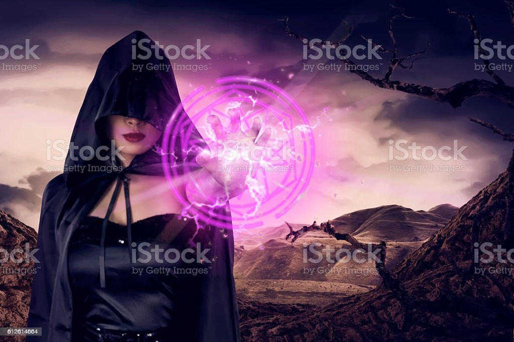 Young asian witch woman show pink pentagram in his hand stock photo