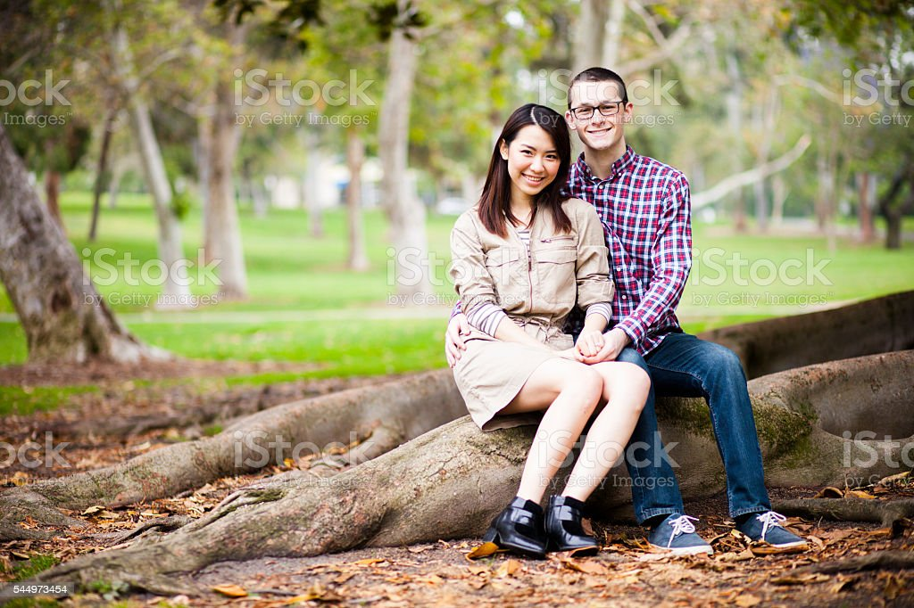 Young Asian Woman and Caucasian Man Couple stock photo