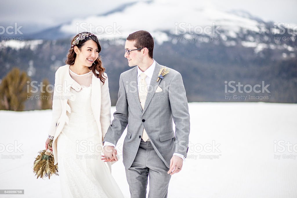 Young Asian Woman and Caucasian Man Wedding Photo stock photo