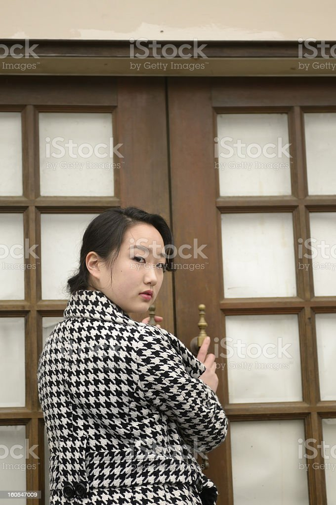 Young asian woman and door royalty-free stock photo
