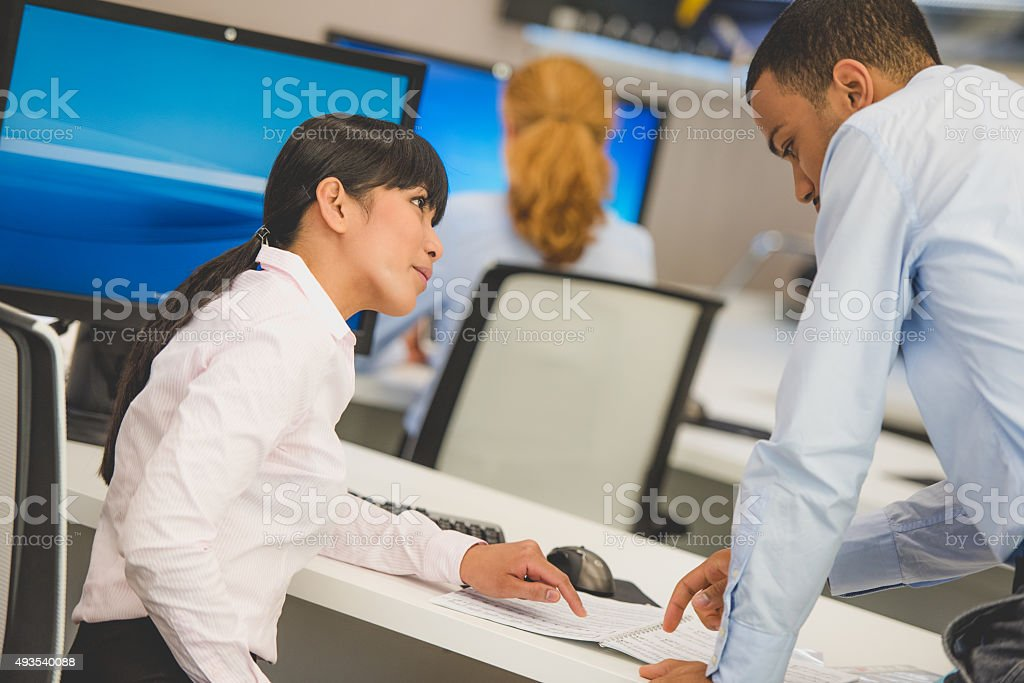 Young asian woman and man in customer support center stock photo