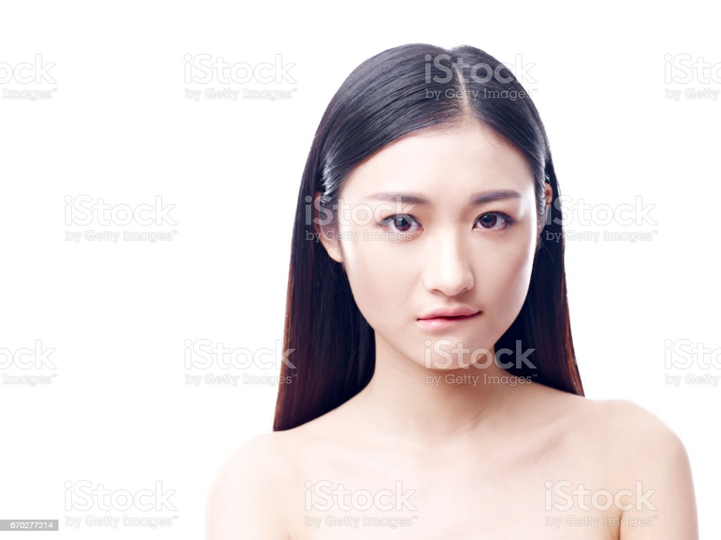 young asian woman appears to be unhappy stock photo