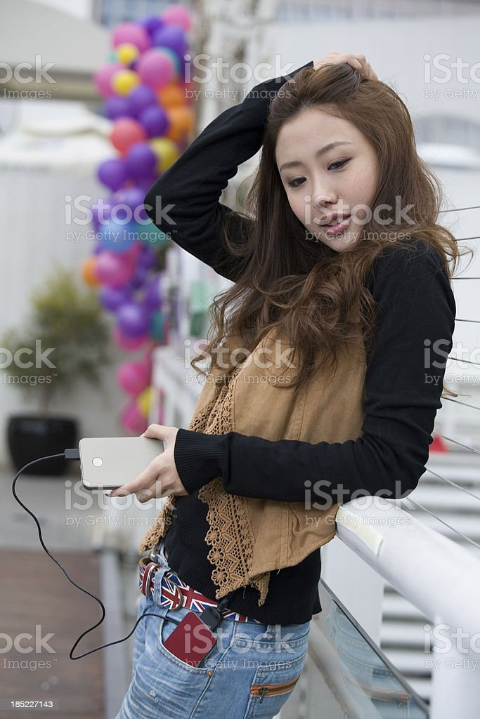 young asian woman benefitting from the high-tech product royalty-free stock photo