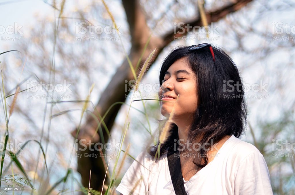 Young asian woman breathing fresh air stock photo