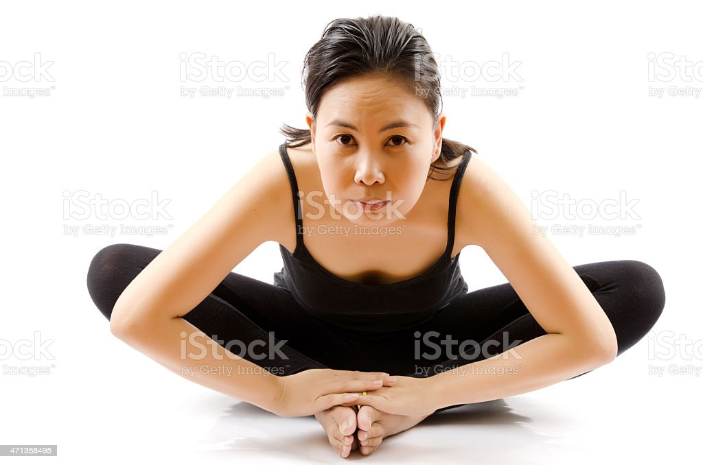 Young Asian woman doing yoga exercise. royalty-free stock photo