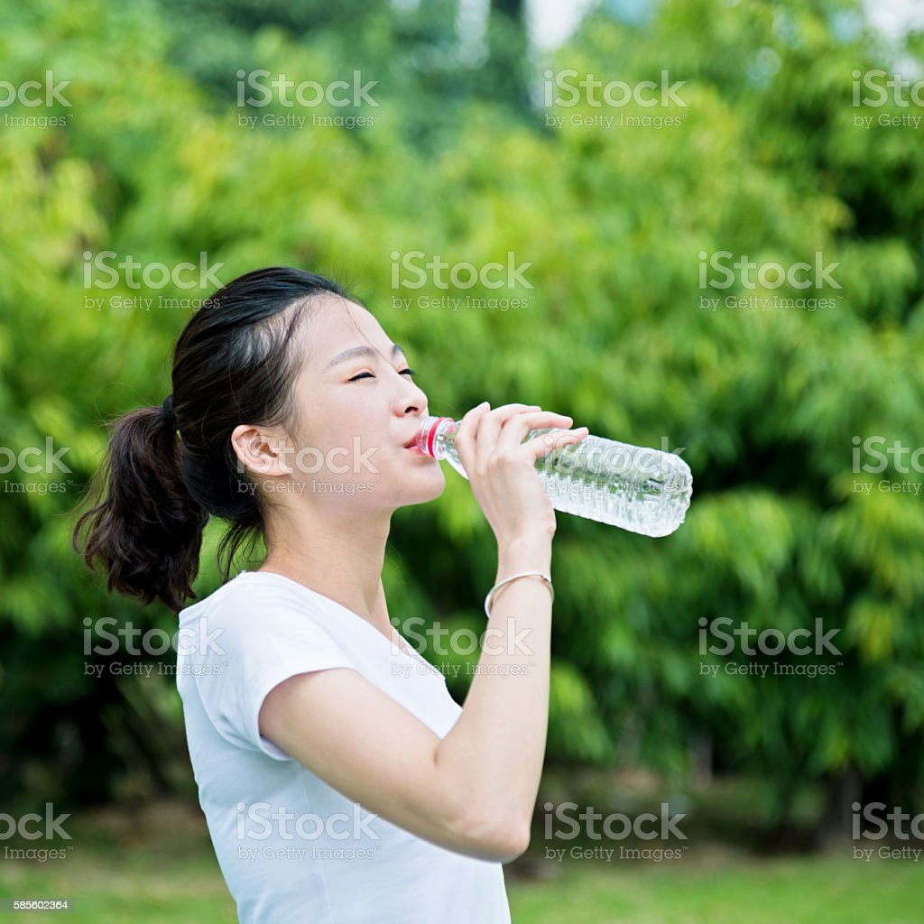 Young asian woman drink water stock photo