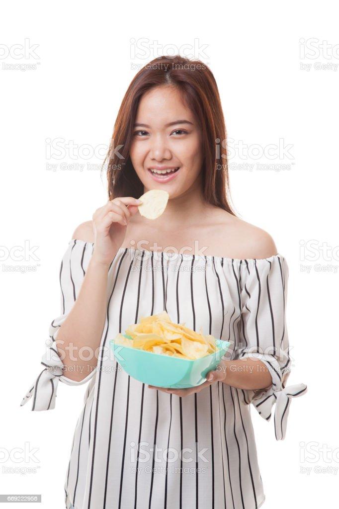 Young Asian woman eat potato chips. stock photo