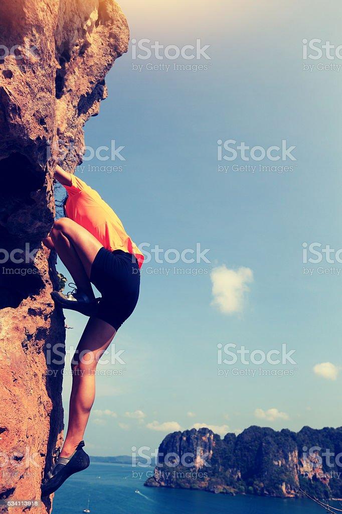 young asian woman enjoy the view at spring mountain peak stock photo