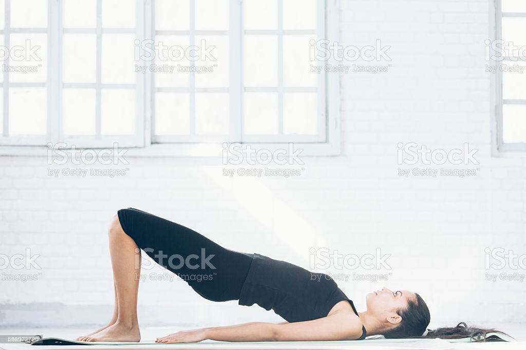 Young asian woman exercising at home stock photo