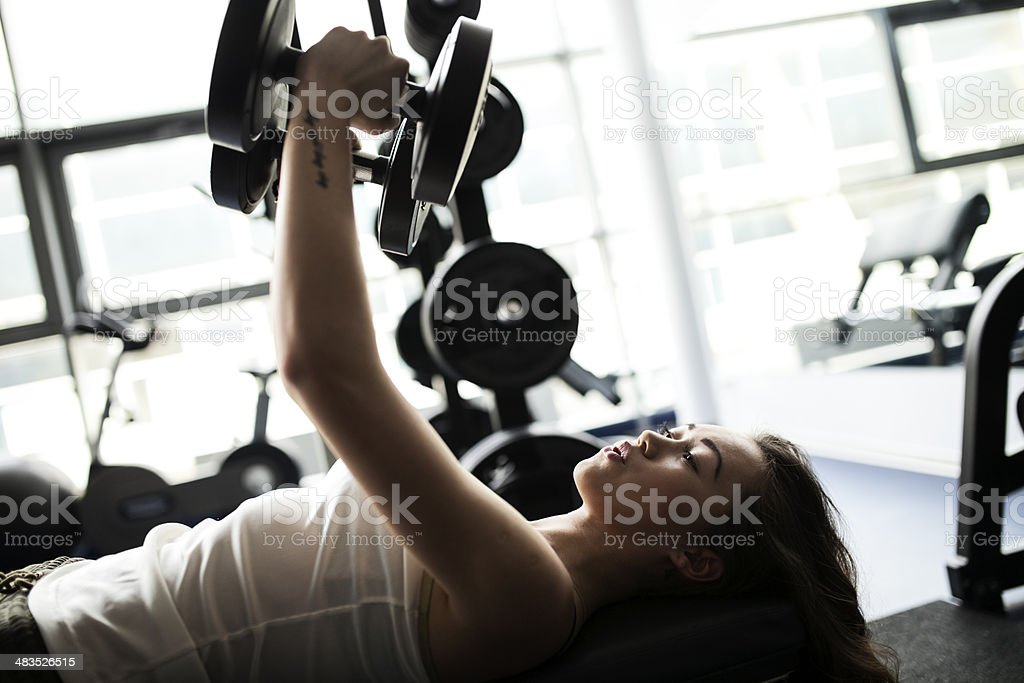 Young Asian Woman Exercising With Dumbbells royalty-free stock photo