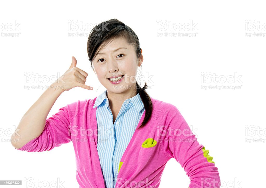 Young asian woman gesturing call sign stock photo