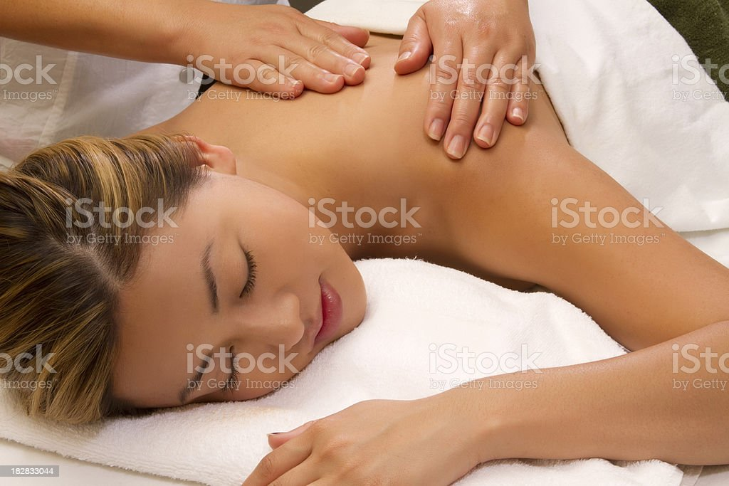 Young Asian woman getting spa treatment royalty-free stock photo