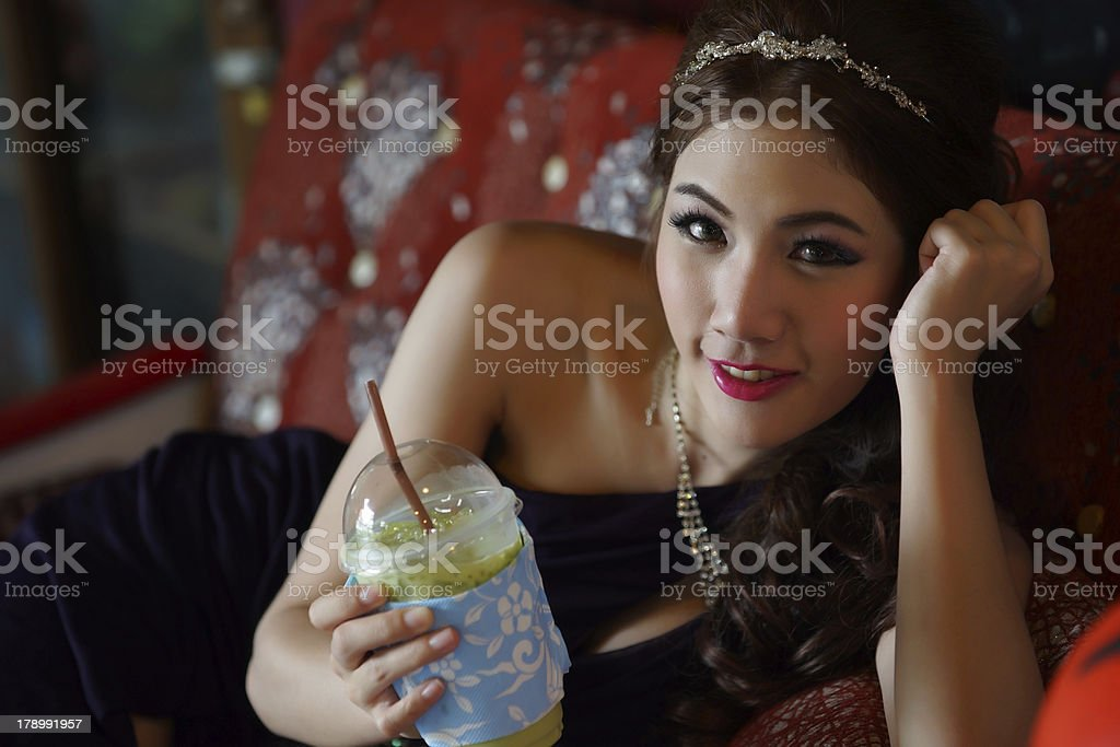 Young Asian woman holding a green tea smoothie royalty-free stock photo