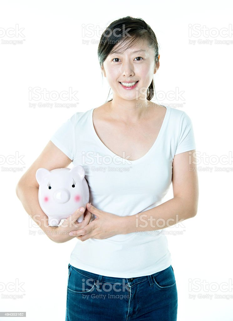 Young asian woman holding piggy bank stock photo