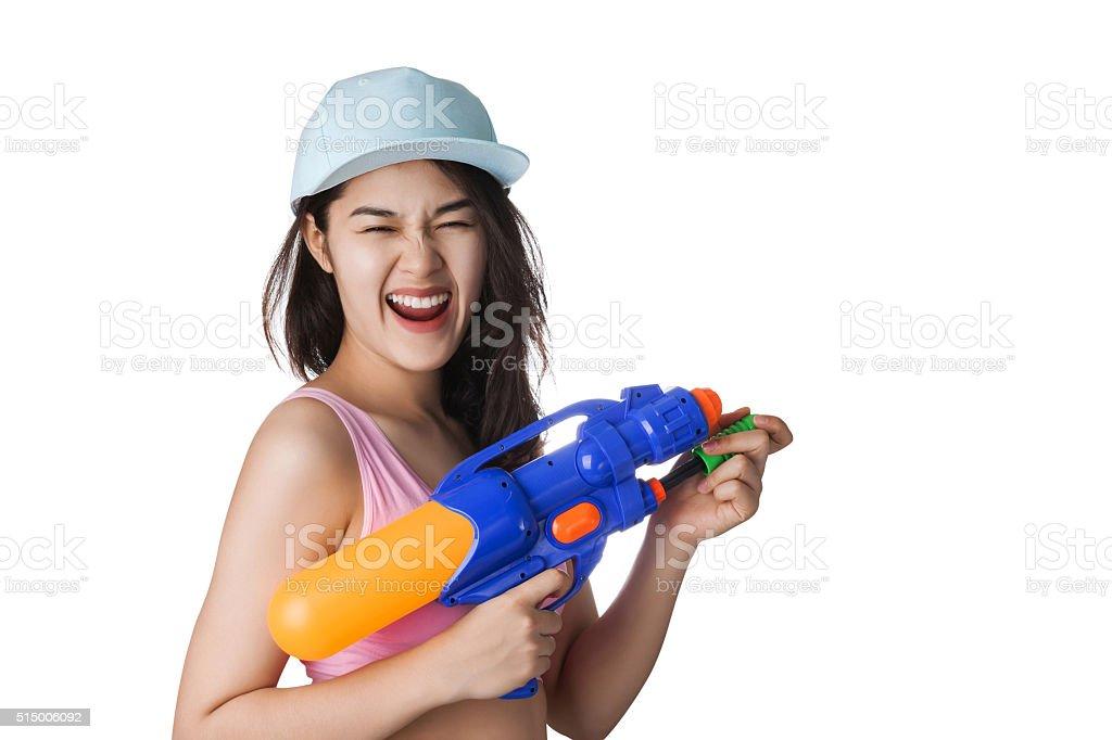 Young Asian woman holding plastic water gun at Songkran day, stock photo