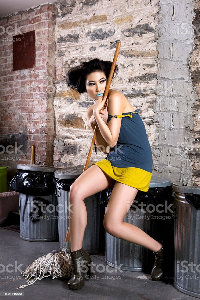 Beautiful Female Asian Model as Cinderlla with Mop, Trash Cans royalty-free stock photo