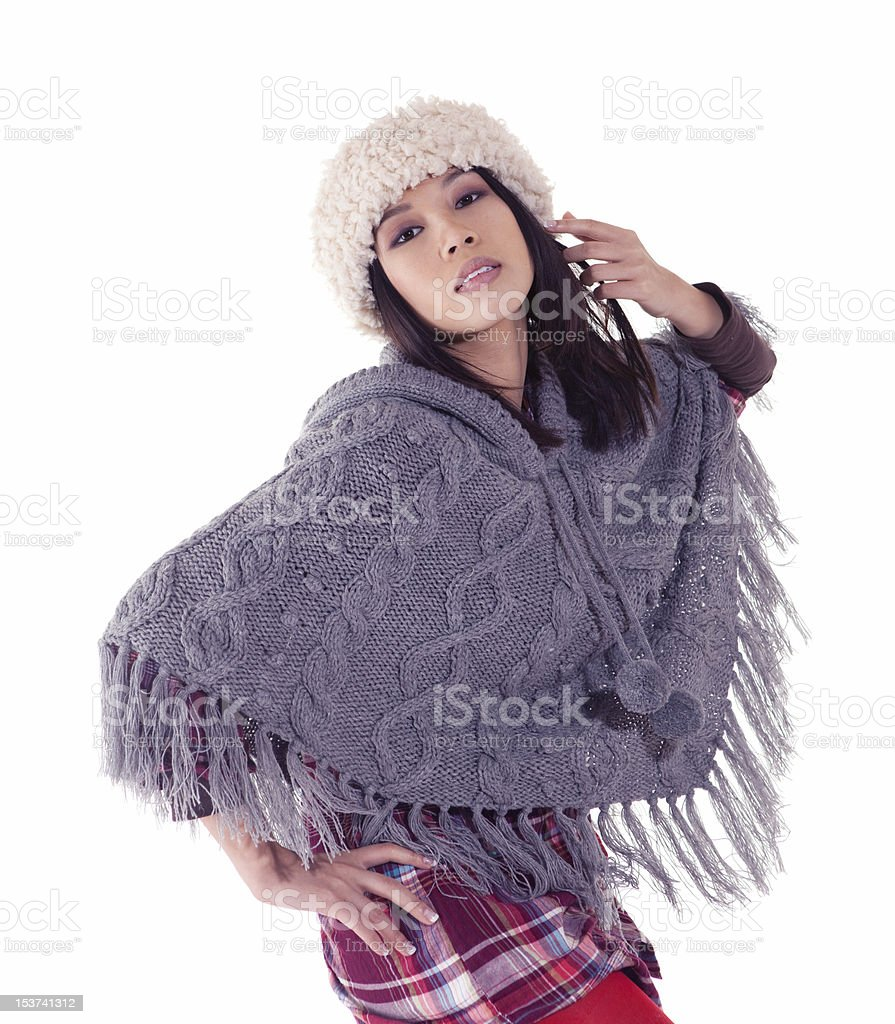 young asian woman  in knitted poncho stock photo