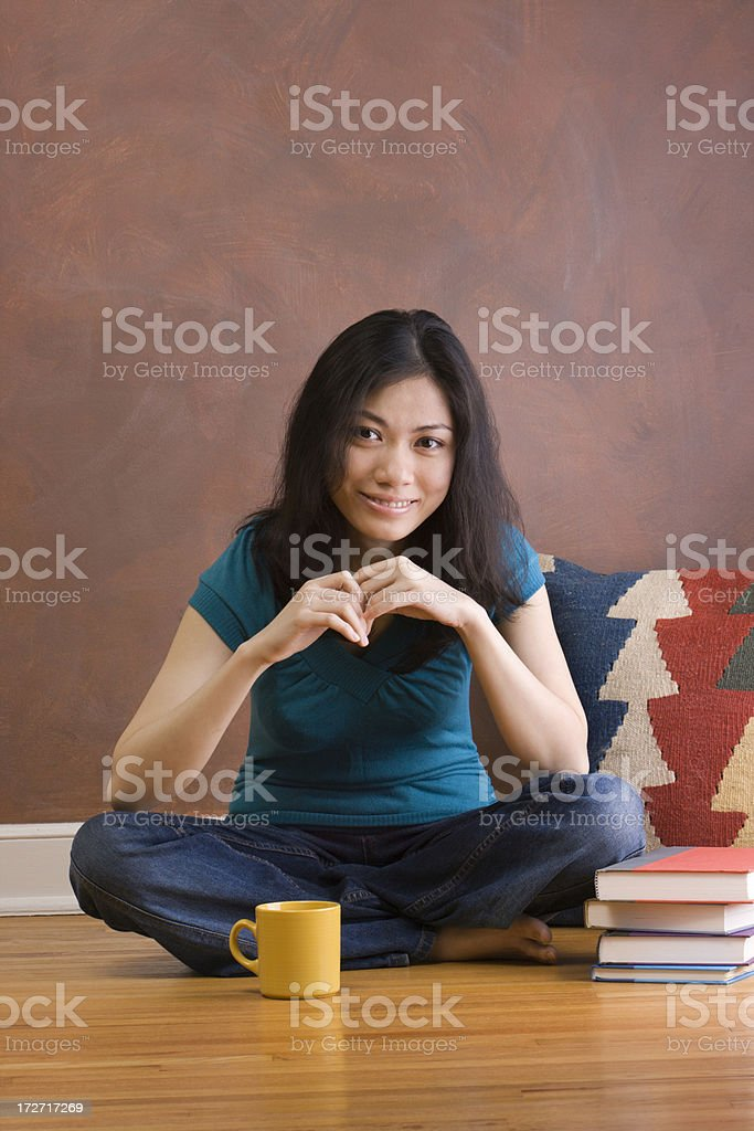 Young Asian Woman in Relaxed Pose royalty-free stock photo