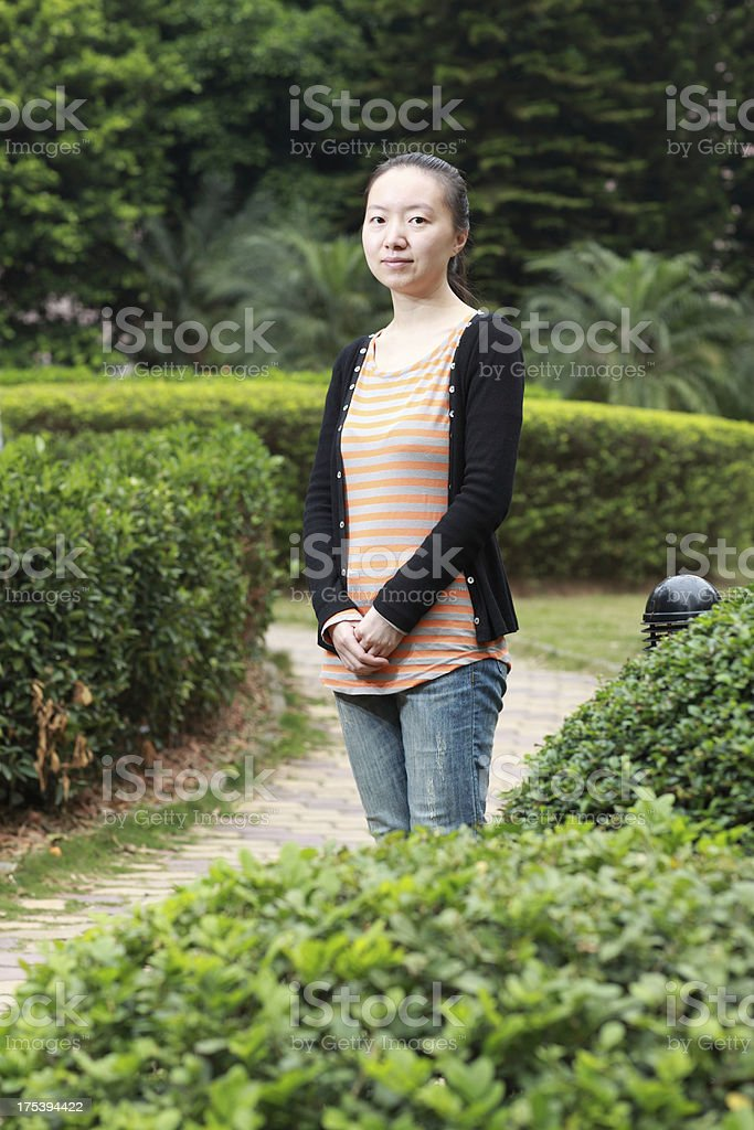 Young asian woman in the park royalty-free stock photo