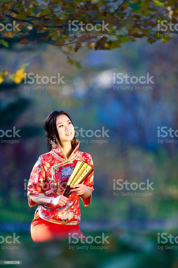 Young asian woman in the rays of autumn sun stock photo