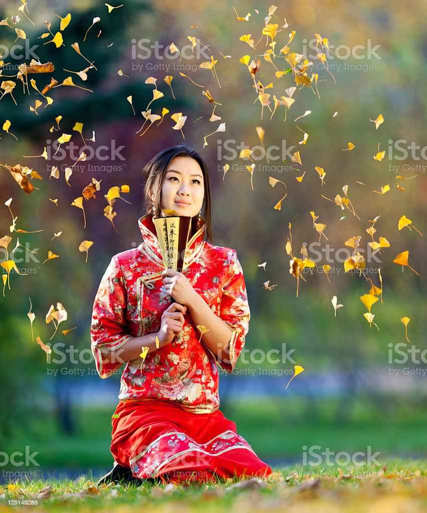 Young asian woman in the rays of autumn sun royalty-free stock photo