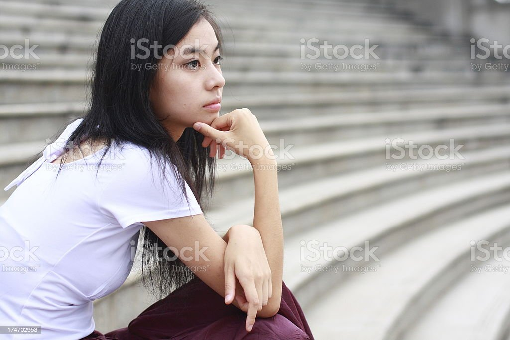 young asian woman is thinking royalty-free stock photo