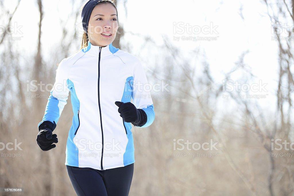 Young Asian woman jogging stock photo
