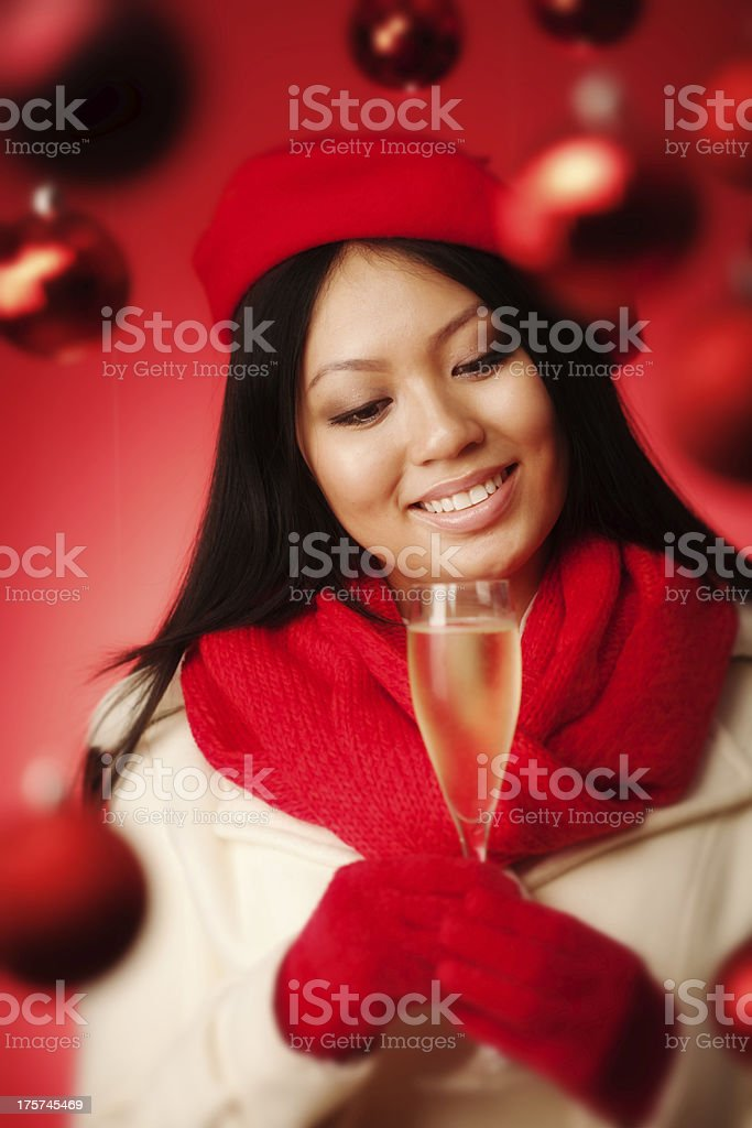 Young Asian Woman Model Holding Champagne in Christmas Background royalty-free stock photo