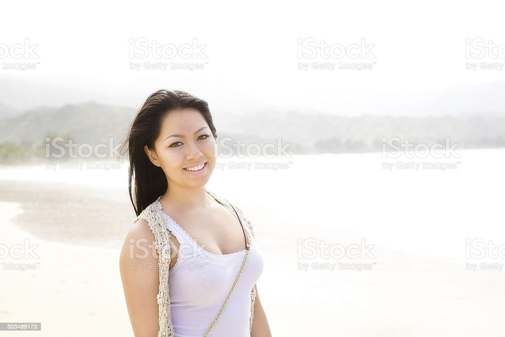Young Asian Woman on Beach of Hanalei Bay, Kauai Hawaii royalty-free stock photo