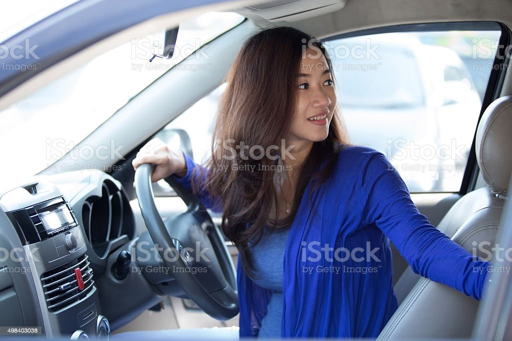 Young Asian woman on ride, a car. stock photo