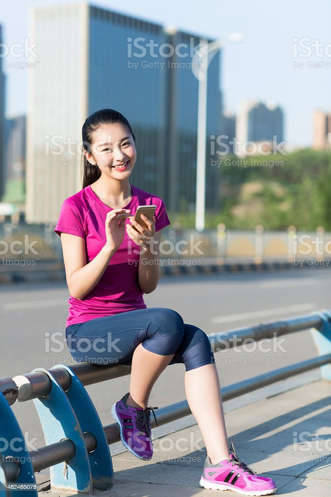 young asian woman on the phone stock photo