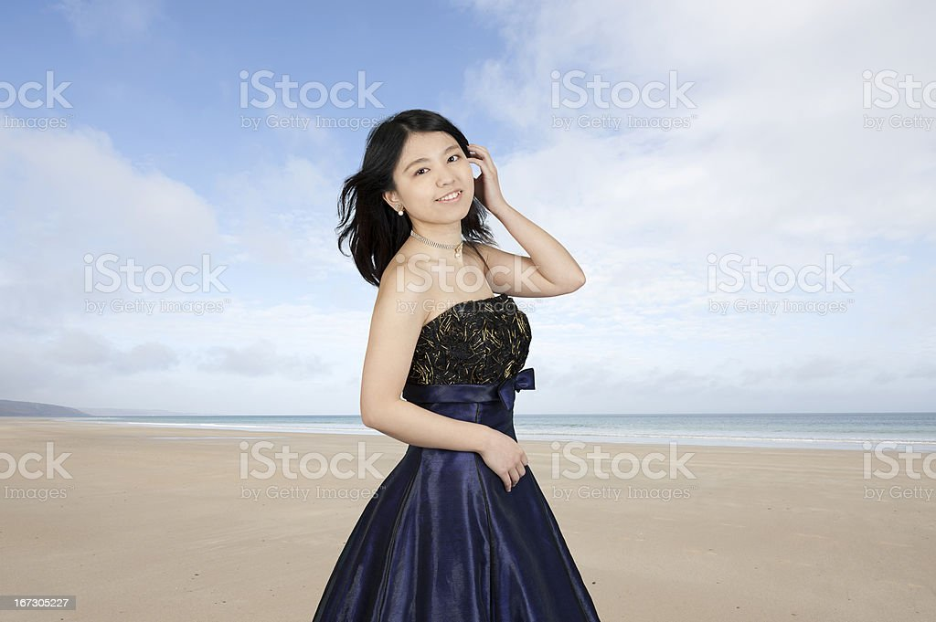 young asian woman outdoors at the beach royalty-free stock photo