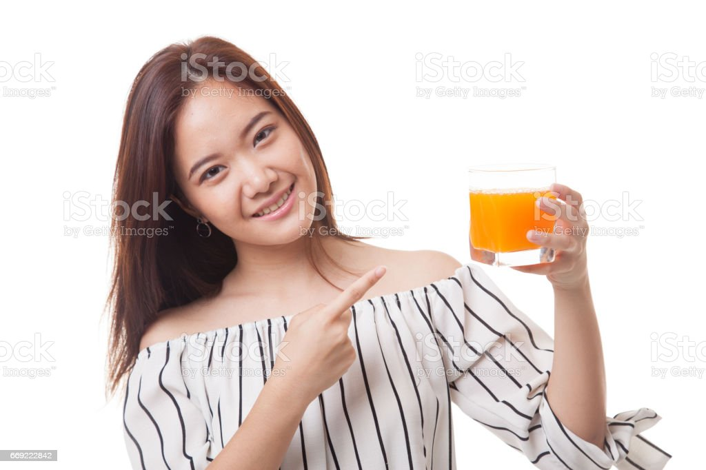 Young Asian woman point to orange juice. stock photo