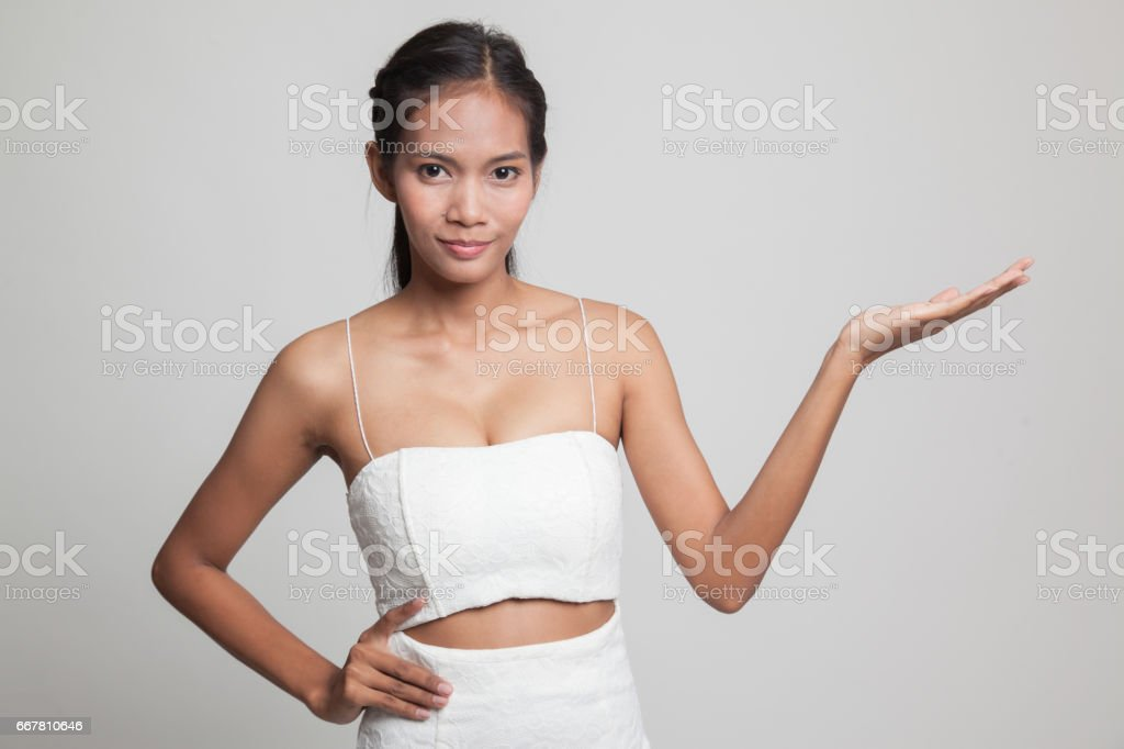 Young Asian woman present with her hand. stock photo