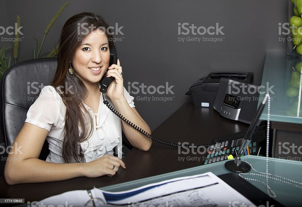 Young Asian Woman Receptionist stock photo