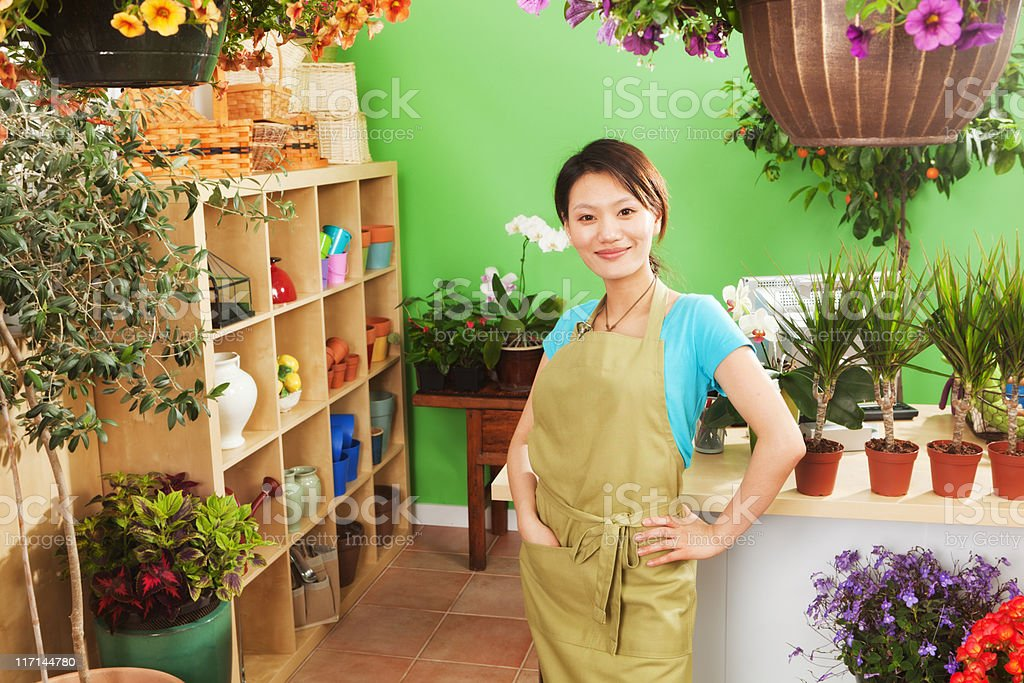Young Asian Woman Retail Business Owner of Garden Center Shop royalty-free stock photo