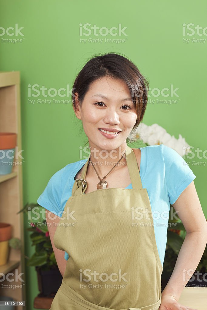 Young Asian Woman Retail Sales Clerk of Garden Center Store royalty-free stock photo