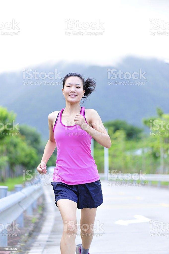 young asian woman running royalty-free stock photo
