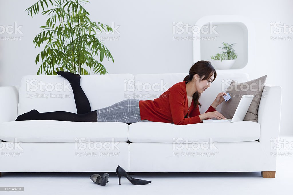 Young Asian Woman Shopping On-line at home with Laptop Computer royalty-free stock photo