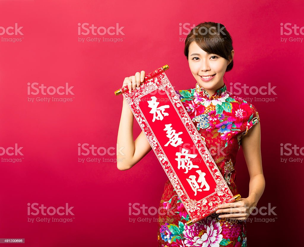young asian woman showing Spring festival couplets stock photo