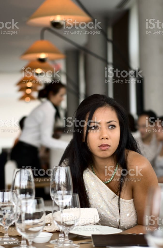 Young Asian Woman Sitting in Fine Dining Restaurant stock photo
