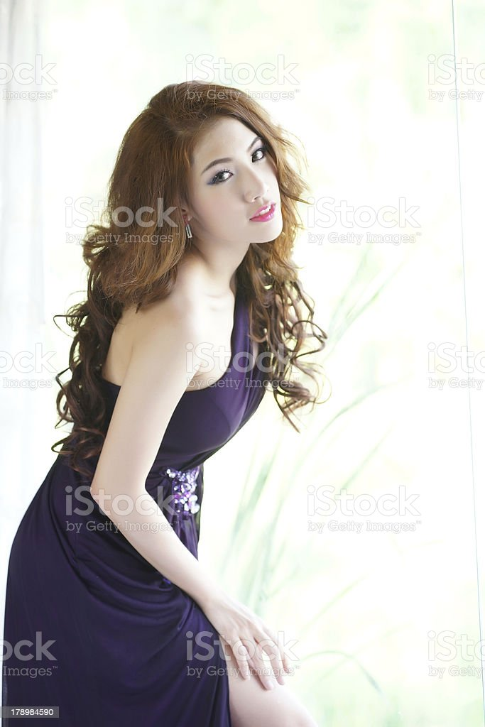 Young Asian woman stand posing near the window royalty-free stock photo